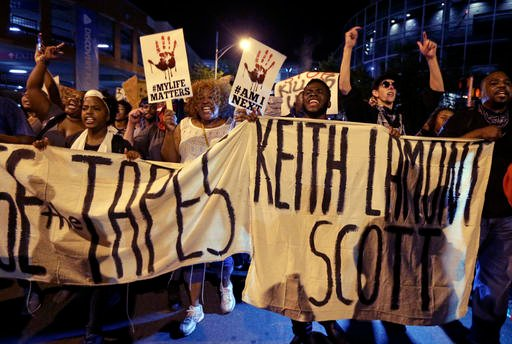 Protesters shout as they march in the streets of Charlotte, N.C. Friday, Sept. 23, 2016, to protest Tuesday's fatal police shooting of Keith Lamont Scott.