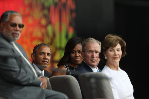 President Barack Obama, second from left, with, from left, Lonnie Bunch, left, director of the Smithsonian Museum of African American History and Culture, first lady Michelle Obama, former President George W. Bush, and former first lady Laura Bush..