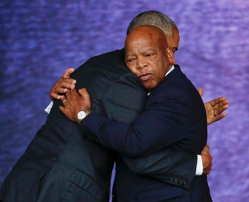 Rep. John Lewis, D-Ga., right, and President Barack Obama embrace at the dedication ceremony.