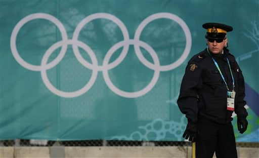A Royal Canadian Mounted Police officer stands outside Pacific Coliseum. (AP Photo/The Canadian Press, Darryl Dyck)