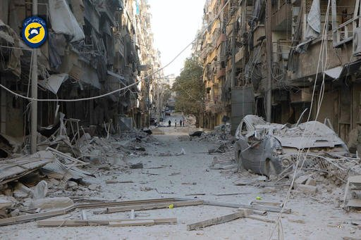 In this photo provided by the Syrian Civil Defense group known as the White Helmets, shows heavily damaged buildings after airstrikes hit in Aleppo, Syria, Saturday, Sept. 24, 2016. Syrian government forces captured a rebel-held area on the edge of Aleppo