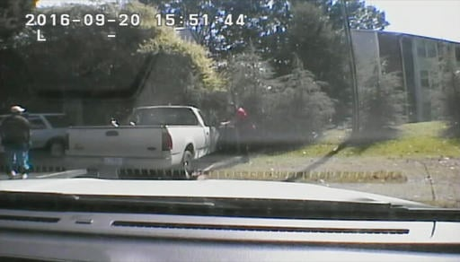 This image made from video provided by the Charlotte-Mecklenburg Police Department on Saturday, Sept. 24, 2016 shows Keith Scott, left, moments before he was fatally shot by police in Charlotte, N.C., on Sept. 20, 2016. (Charlotte-Mecklenburg Police Depar