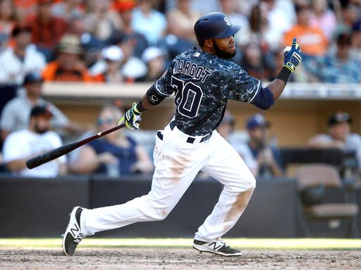 San Diego Padres' Manuel Margot hits a triple against the San Francisco Giants during the seventh inning of a baseball game in San Diego, Sunday, Sept. 25, 2016. (AP Photo/Alex Gallardo)