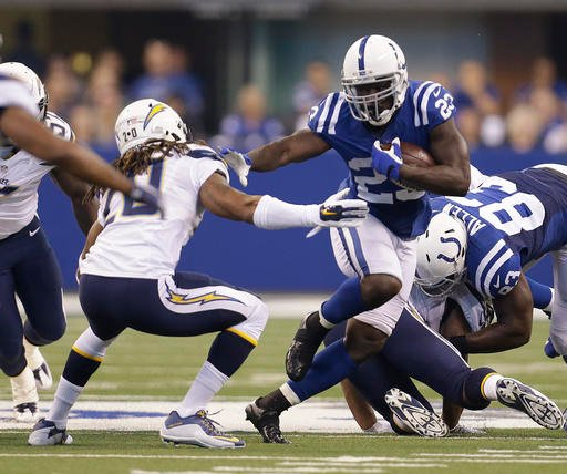 Indianapolis Colts' Frank Gore (23) runs past San Diego Chargers' Dwight Lowery (20) during the first half of an NFL football game, Sunday, Sept. 25, 2016, in Indianapolis. (AP Photo/AJ Mast)