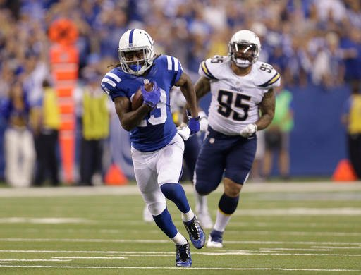 Indianapolis Colts' T.Y. Hilton (13) runs past San Diego Chargers' Tenny Palepoi (95) for a 63-yard touchdown reception during the second half of an NFL football game, Sunday, Sept. 25, 2016, in Indianapolis. (AP Photo/AJ Mast)