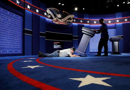 Technicians set up the stage for the debate between Democratic presidential candidate Hillary Clinton and Republican presidential candidate Donald Trump at Hofstra University in Hempstead, N.Y. Sept. 25, 2016. (AP Photo/Patrick Semansky)