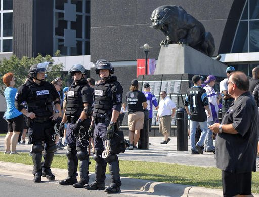 Police officers stand outside Bank of America Stadium for an NFL football game between the Minnesota Vikings and the Carolina Panthers Sept. 25, 2016. (AP Photo/Skip Foreman)