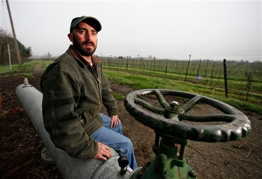 Vineyard manager Paul Foppiano sits by a water pumping station at Foppiano Vineyards in Healdsburg, Calif., Thursday, Jan. 28, 2010. (AP Photo/Eric Risberg)