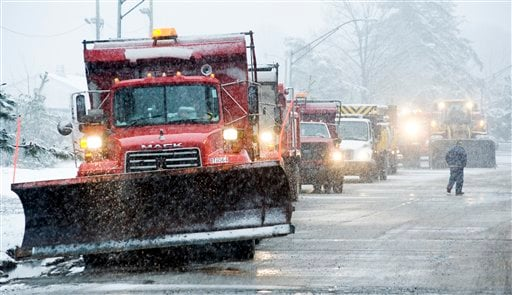 Snow plows wait in line alongside I-95/495 in Alexandria, Va., 2/5/10. Life in the nation's capital ground to a halt Friday as steady snow fell, the beginning of a storm forecasters said could be the biggest in modern history. (AP Photo/Cliff Owen)