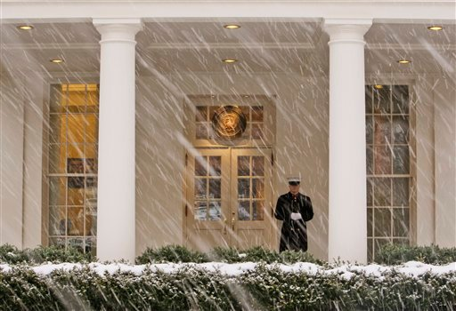 A Marine stands sentry as the snow falls while President Barack Obama works in the West Wing of the White House in Washington, Friday, Feb. 5, 2010. (AP Photo/Charles Dharapak)