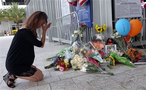 Junko Sasaki of Japan cries at a memorial for Jose Fernandez at Marlins Park in Miami after the game against the Atlanta Braves was canceled because of the death of pitcher Jose Fernandez.