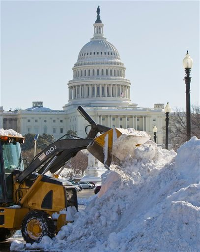 Snow is piled high in front of the Capitol in Washington, Monday, Feb. 8, 2010, from last week's snow storm, one of the worst snow storms in history in Washington. (AP Photo/Alex Brandon)