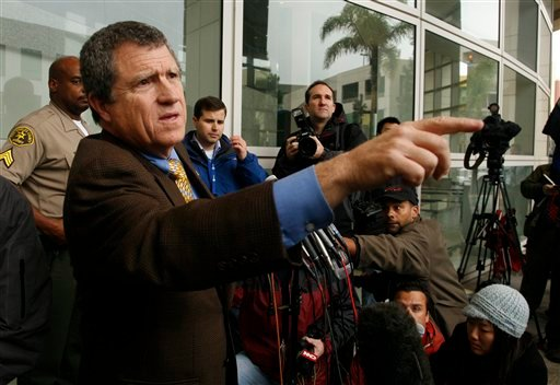Los Angeles County Sheriff's Department Spokesman Steve Whitmore, left, calls off media gathered at Airport Courthouse in Los Angeles on Friday, Feb. 5, 2010.  (AP Photo/Jason Redmond)