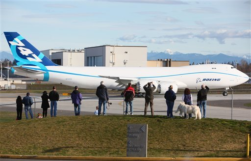 Spectators gather to watch the new Boeing 747-8 freighter during taxi tests for the new airplane on Saturday Feb. 6, 2010 at Paine Field in Everett, Wash. (AP Photo/Seattlepi.com, Joshua Trujillo)