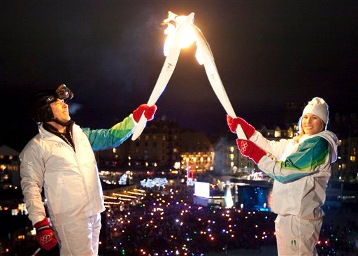 The Olympic Flame is on a 106 day cross country relay which will end in Vancouver on Feb. 12, 2010 to mark the start of the Vancouver 2010 Winter Olympic Games. (AP Photo/The Canadian Press, Jonathan Hayward)