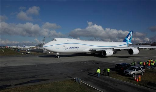 The Boeing 747-8 Freighter taxis for take off on its first flight, Monday, Feb. 8, 2010, in Everett, Wash. (AP Photo/Ted S. Warren)