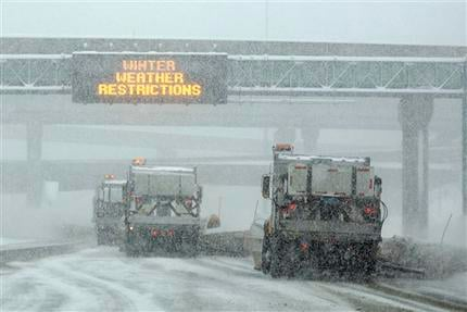 A Pennsylvania Department of Transportation snowplow train works to clear Interstate 81 during a blizzard in Harrisburg, Pa., Wednesday, Feb. 10, 2010. (AP Photo/Carolyn Kaster)