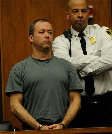 Mark Kerrigan, 45, the brother of Olympic figure skater Nancy Kerrigan, is arraigned in Woburn, Mass. District Court Monday, Jan. 25, 2010. (AP Photo/Pool, Ted Fitzgerald)