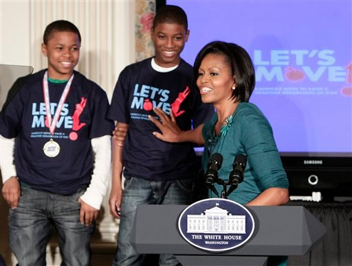 First lady Michelle Obama points out some student athletes as she announces a campaign to combat the rapidly growing problem of childhood obesity, Tuesday, Feb. 9, 2010, in the State Dining Room of the White House. (AP Photo/J. Scott Applewhite)