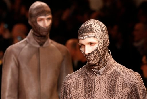 Models wear creations of Alexander McQueen men's Fall-Winter 2010/2011 collection, part of the Milan Fashion Week, unveiled in Milan, Italy, Monday, Jan. 18, 2010. (AP Photo/Antonio Calann