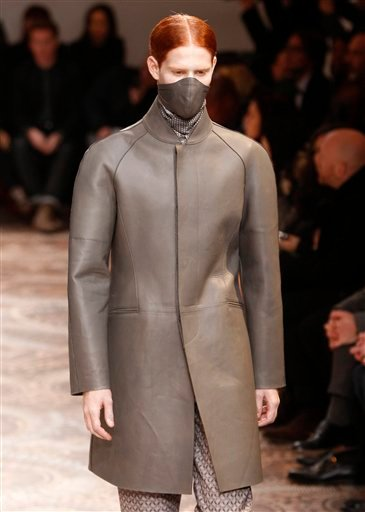 A model wears a creation of Alexander McQueen men's Fall-Winter 2010/2011 collection, part of the Milan Fashion Week, unveiled in Milan, Italy, Monday, Jan. 18, 2010. (AP Photo/Antonio Calanni)