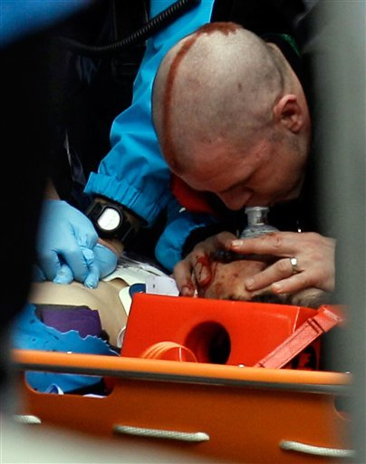 Nodar Kumaritashvili of Georgia is seen being given chest compressions and mouth-to-mouth resuscitation after crashing during a training run for the men's singles luge at the Vancouver 2010 Olympics. (AP Photo/Michael Sohn)
