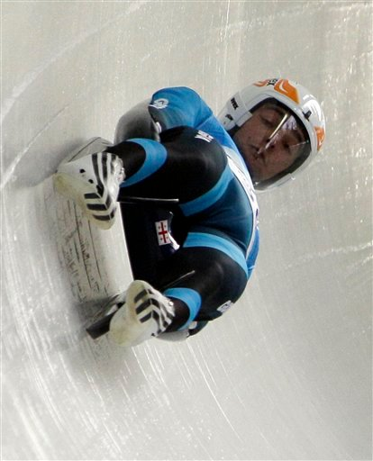 Nodar Kumaritashvili of Georgia is seen just before crashing during a training run for the men's singles luge at the Vancouver 2010 Olympics in Whistler, British Columbia, Friday, Feb. 12, 2010. (AP Photo/Ricardo Mazalan)
