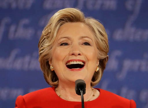 Democratic presidential nominee Hillary Clinton laughs during the presidential debate with Republican presidential nominee Donald Trump at Hofstra University in Hempstead, N.Y., Monday, Sept. 26, 2016. (AP Photo/Julio Cortez)
