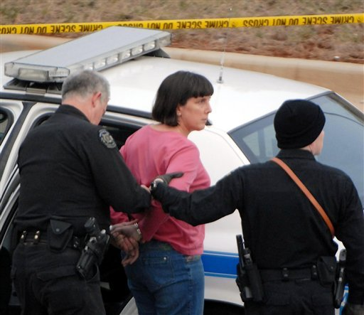 Amy Bishop is taken into custody by Huntsville, Ala. police Friday, Feb 12, 2010 in connection with fatal shootings on the University of Alabama in Huntsville campus in the Shelby Center in Huntsville, Ala. (AP Photo/Huntsville Times, Dave Dieter)