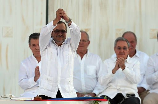 Top commander of the Revolutionary Armed Forces of Colombia (FARC) Rodrigo Londono, known by the alias Timochenko, gestures after signing the peace agreement between Colombia's government and the FARC, to end over 50 years of conflict, in Cartagena, Colom