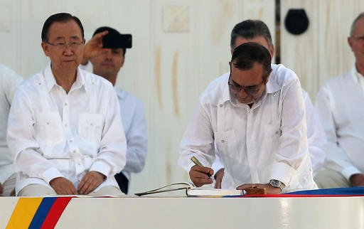 Top commander of the Revolutionary Armed Forces of Colombia (FARC) Rodrigo Londono, known by the alias Timochenko, signs the peace agreement between Colombia's government and the FARC, to end over 50 years of conflict, in Cartagena, Colombia, Monday, Sept