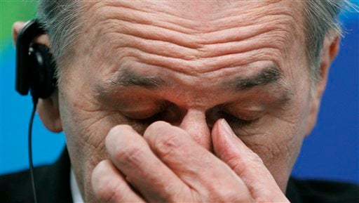 IOC President Jacques Rogge rubs his face as he reacts during a news conference where he spoke about the death of Georgian luge athlete Nodar Kumaritashvili at the main press center for the Vancouver 2010 Olympics in Vancouver, British Columbia.