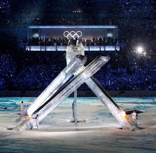 Olympic torchbearers light the cauldron during the opening ceremony for the Vancouver 2010 Olympics in Vancouver, British Columbia, Friday, Feb. 12, 2010. (AP Photo/David J. Phillip)