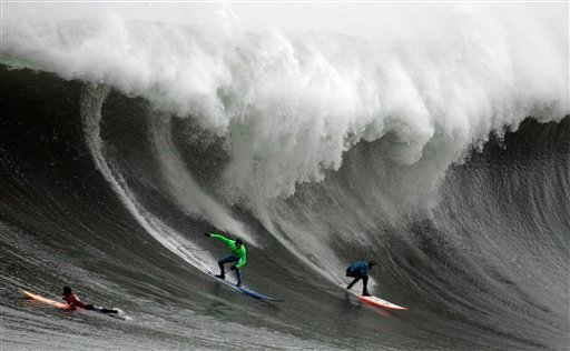 In this Jan. 12, 2008, file photo, Greg Long, left, and Jamie Sterling surf a giant wave during the Mavericks surf contest in Half Moon Bay, Calif.