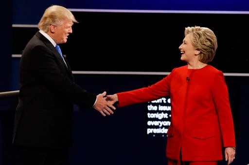 Republican presidential nominee Donald Trump and Democratic presidential nominee Hillary Clinton shake hands during the presidential debate.