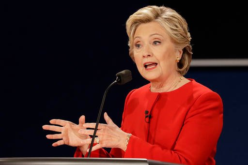 Democratic presidential nominee Hillary Clinton answers a question during the presidential debate with Republican presidential nominee Donald Trump.