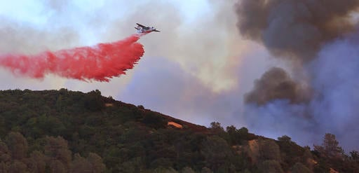 Cal Fire air tanker makes a drop on the head of the Sawmill fire in the Geysers near Cloverdale Calif.