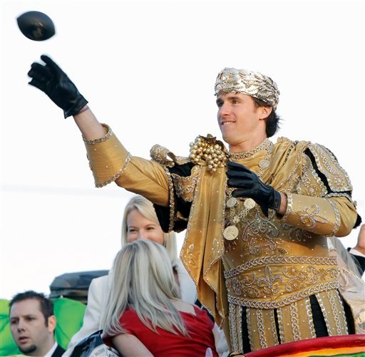 New Orleans Saints quarterback Drew Brees hrows a small football while riding in the Bacchus Mardi Gras parade in New Orleans, Sunday, Feb. 14, 2010. The Saints won Super Bowl XLIV on Feb. 7. (AP Photo/Bill Haber)