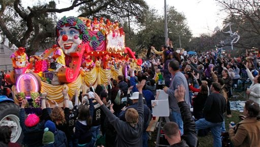 One of the floats in the Bacchus Mardi Gras parade makes its way through the streets of New Orleans, Sunday, Feb. 14, 2010. (AP Photo/Bill Haber)