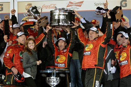 Jamie McMurray, center, with crew, celebrates in victory lane after winning the Daytona 500 NASCAR auto race at Daytona International Speedway in Daytona Beach, Fla., Sunday, Feb. 14, 2010. (AP Photo/John Raoux)