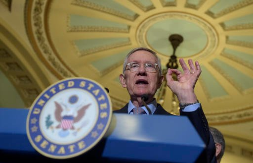 In this Sept. 13, 2016 file photo, Senate Minority Leader Sen. Harry Reid of Nev. speaks to reporters during a news conference on Capitol Hill in Washington. Democrats opened a last-minute push Tuesday, Sept. 27, 2016, for new talks on must-do legislation