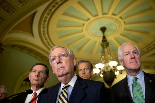 In tis June 21, 2016, file photo, Senate Majority Leader Mitch McConnell of Ky., accompanied by, from left, Sen. John Barrasso, R-Wyo., Sen. John Thune, R-S.D., and Senate Majority Whip John Cornyn of Texas, listen to a question during a news conference o