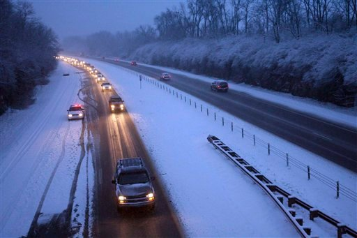 The I64 Westbound, in Louisville, Ky. is backed up with only one lane of traffic with snow on the ground and more snow expected throughout the day, Monday Feb. 15, 2010. (AP Photo/The Courier-Journal, Kylene Lloyd)