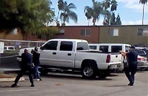 Crowds gather after police fatally wound unarmed black man in southern California