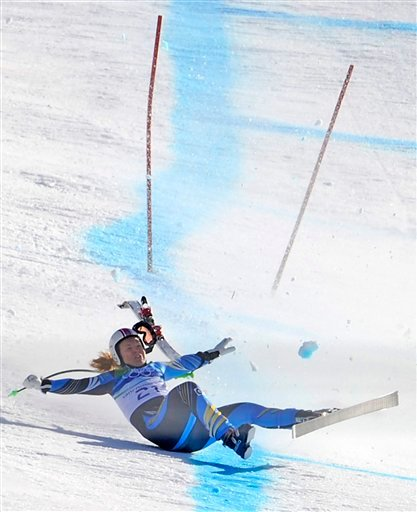 Sweden's Anja Paerson crashes near the finish of the Women's downhill at the Vancouver 2010 Olympics in Whistler, British Columbia, Wednesday, Feb. 17, 2010. (AP Photo/Gero Breloer)