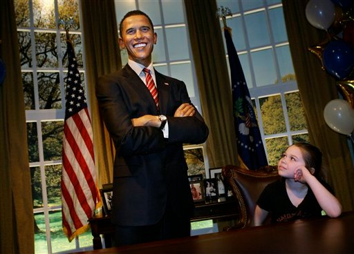 "Jaden Bubolz of Suring, Wisc. looks upon a $300,000 wax replica of Barack Obama while visiting ""The Oval Office Experience"" at Madame Tussauds Wax Museum in Las Vegas on Monday, Feb. 15, 2010."