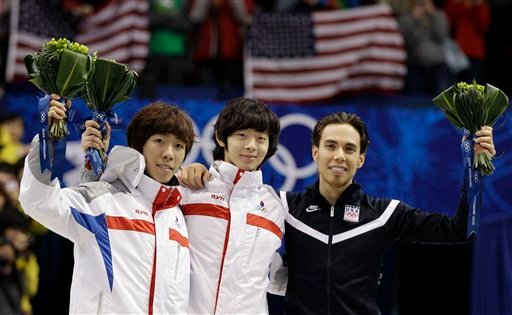 Gold medallist Lee Jung-Su of South Korea, center, silver medallist Lee Ho-Suk of South Korea, left, and bronze medallist Apolo Anton Ohno of the USA, right. (AP Photo/Mark Baker)