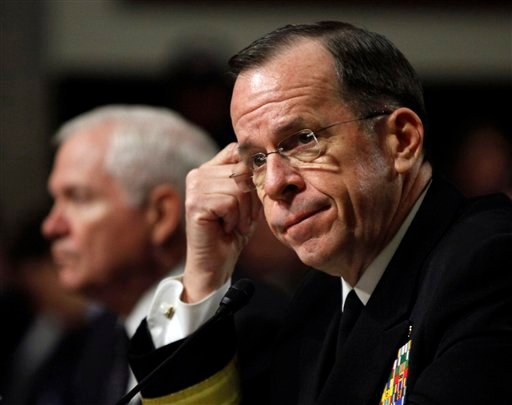 """In this Feb. 2, 2010, file photo Joint Chiefs Chairman Adm. Michael Mullen and Defense Secretary Robert Gates, left, testify on Capitol Hill in Washington at a hearing related to the """"Don't Ask, Don't Tell"""" policy."""