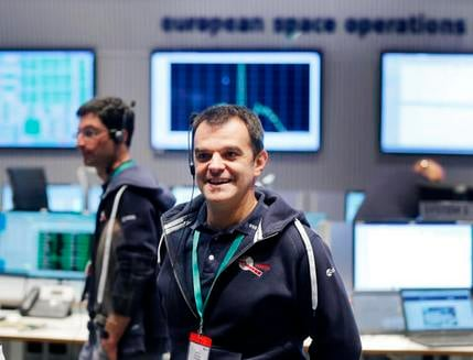 Flight director Andrea Accomazzo smiles in the control room at the European Space Agency ESA in Darmstadt, Germany, Friday, Sept. 30, 2016.