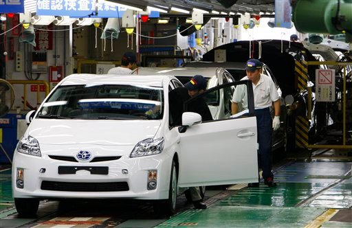 Toyota Motor Corp. is recalling nearly 200,000 of its signature Prius green cars in Japan for braking problems, the latest in a string of embarrassing safety lapses at the world's largest automaker. (AP Photo/Shizuo Kambayashi)